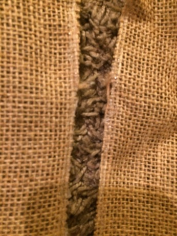 seal the free burlap edge with a bead of hot glue